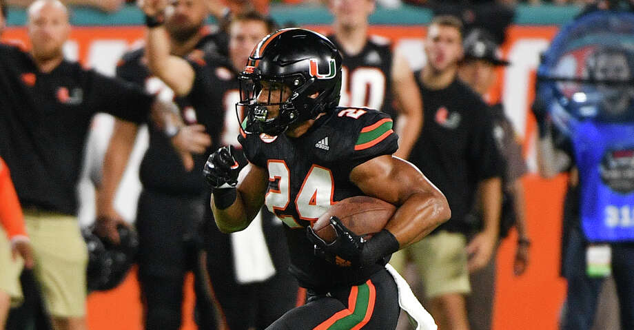 PHOTOS: Free agents Travis Homer #24 of the Miami Hurricanes runs with the ball against the North Carolina Tar Heels at Hard Rock Stadium on September 27, 2018 in Miami, Florida. (Photo by Mark Brown/Getty Images) Browse through the photos to see the best available free agents in the NFL this offseason. Photo: Mark Brown/Getty Images / 2018 Mark Brown