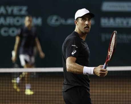 Steve Johnson reacts after losing a game to Daniel Elahi Galan in the second round of action during the Fayez Sarofim & Co. U.S. Men's Clay Court Championship at River Oaks Country Club, Thursday, April 11, 2019, in Houston.