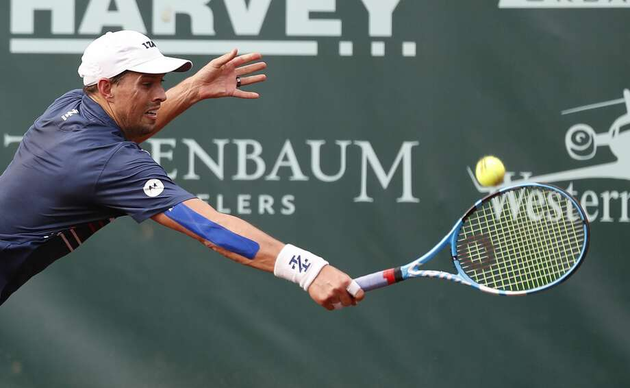 Mike Bryan returns the ball as he played doubles with his brother against Jeevan Nedunchezhiyan and Purav Raja during the Fayez Sarofim & Co. U.S. Men's Clay Court Championship at River Oaks Country Club, Thursday, April 11, 2019, in Houston. Photo: Karen Warren/Staff Photographer