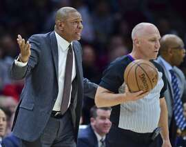 Los Angeles Clippers head coach Doc Rivers disputes a call with a referee in the first half of an NBA basketball game against the Cleveland Cavaliers, Friday, March 22, 2019, in Cleveland. The Clippers won 110-108. (AP Photo/David Dermer)