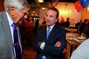 Mayor Joe Ganim chats with Edward Marcus, left, during a fundraiser for his mayoral campaign at Brewport restaurant in Bridgeport, Conn., on Tuesday April 9, 2019. Marcus, who has supported Ganim since the 1990s, is a former Democratic State Chairman and former Senate Majority Leader. This is the first fundraiser Ganim has held since last raising money in 2017.