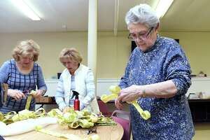 In New Haven, from left, Therese Incarnato of New Haven, Mary Florenzano of New Haven and Mary Quinlan of East Haven assemble palm crosses for Palm Sunday in the basement of St. Michael Church April 11, 2019. This is the third year that volunteers under the direction of Jean Quartiano have made palm crosses for parishioners of the church.