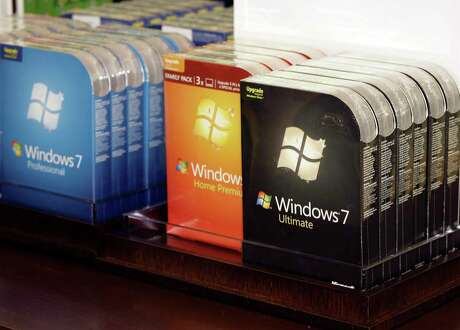 Packages of Microsoft's newly-released operating system, Windows 7, are lined up for purchase inside the company's first retail store grand opening Thursday, Oct. 22, 2009, in Scottsdale, Ariz. (AP Photo/Paul Connors)