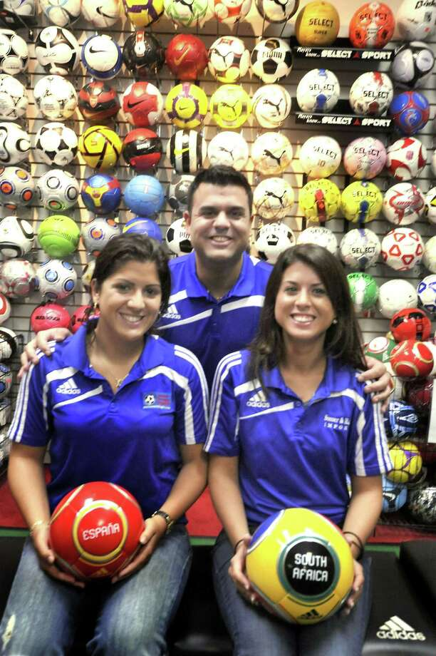 The Avolos family members in Soccer & Rugby Imports on Monday, Jan.25,2010. At left is Jessica, center is Gus, and right is Michelle, who all work at the Family owned business in Ridgefield and Greenwich. Photo: Michael Duffy / ST / The News-Times