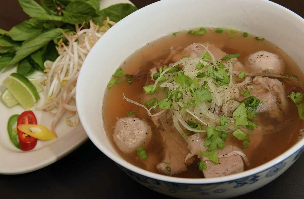 Beef noodle soup (pho) eye round, brisket, meatballs, tripe, traditional Vietnamese rice noodle soup with scallion, onion, cilantro, served with bean sprouts, Thai basil, jalapeno, and lime at Quang's Vietnamese Bistro on Thursday, April 4, 2019 in Troy, N.Y. (Lori Van Buren/Times Union)