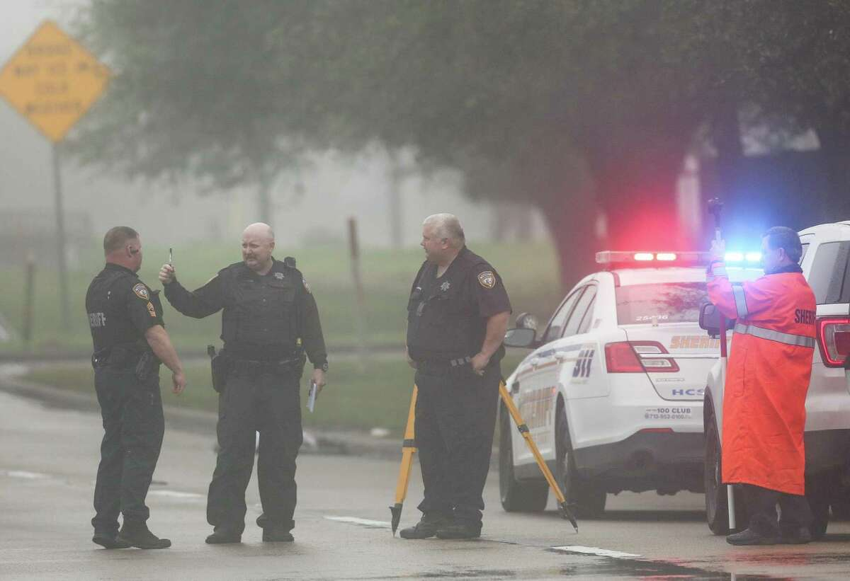 Harris County Sheriff's Office deputies investigate the scene where a motorist fatally struck a pedestrian on the West Sam Houston Parkway feeders road, just south of Philippine Street Wednesday, Feb. 27, 2019, in Houston.