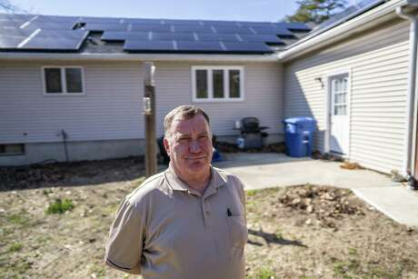 VINCENTOWN, NJ: MARCH 28, 2019 Al Morgan, 64, at his home in Vincentown, New Jersey on March 28, 2019. Mr. Morgan leased a solar panel system from Sunnova, a company based in Houston, after he was assured he'd pay a lot less for electricity. He now claims is bill is even higher than before. (Jessica Kourkounis for the Houston Chronicle)