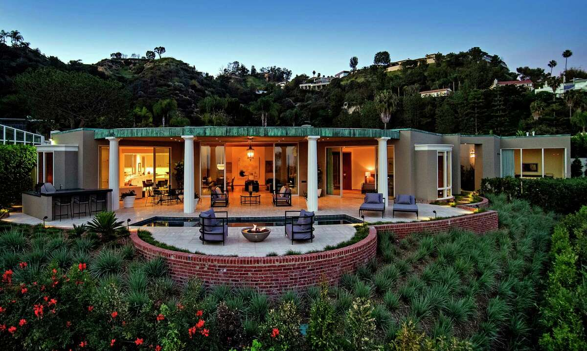 Serial homebuyers and sellers Ellen DeGeneres and Portia de Rossi are seeking about $18 million for a Beverly Hills home they bought about seven months ago Once owned by actress Marjorie Lord, the Hollywood Regency-style house was designed by John Elgin Woolf and built in 1962. The 5,100-square-foot house was recently restored by L.A.-based firm Marmol Radziner. (Jim Bartsch)
