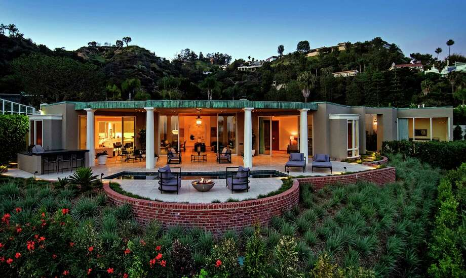 Serial homebuyers and sellers Ellen DeGeneres and Portia de Rossi are seeking about $18 million for a Beverly Hills home they bought about seven months ago Once owned by actress Marjorie Lord, the Hollywood Regency-style house was designed by John Elgin Woolf and built in 1962. The 5,100-square-foot house was recently restored by L.A.-based firm Marmol Radziner. (Jim Bartsch) Photo: Jim Bartsch / Los Angeles Times