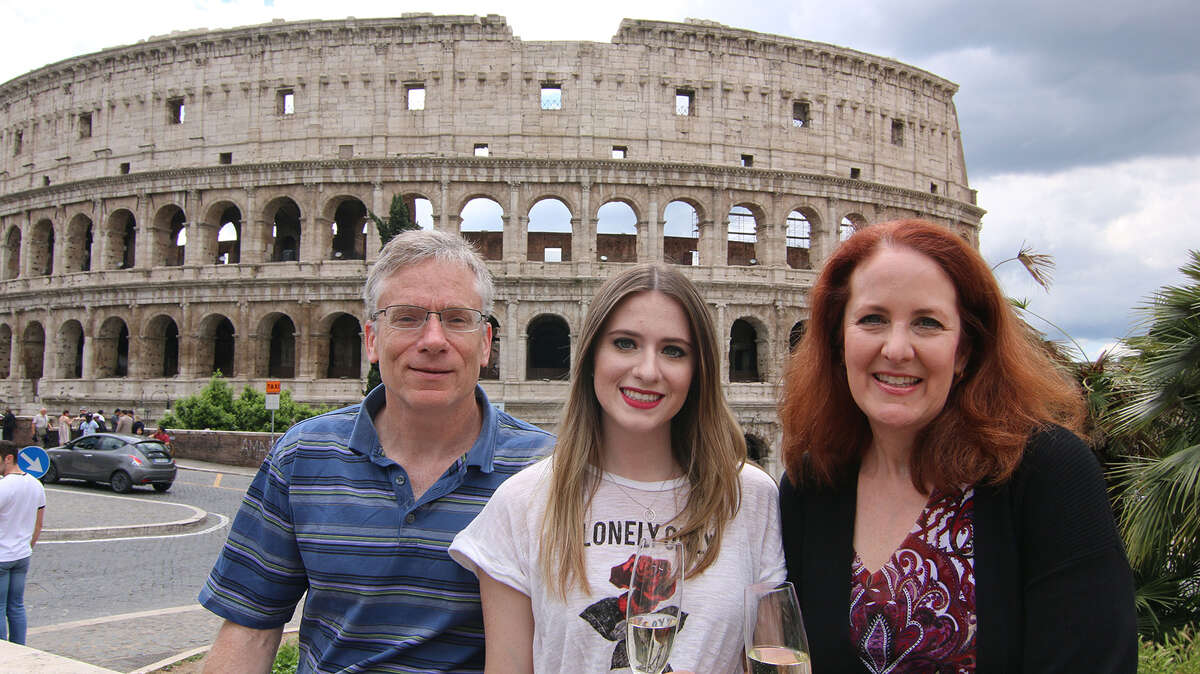 Ron and Hilary Shenfeld with their daughter Samantha outside the Colosseum in Rome. (Hilary Shenfeld/Chicago Tribune/TNS)