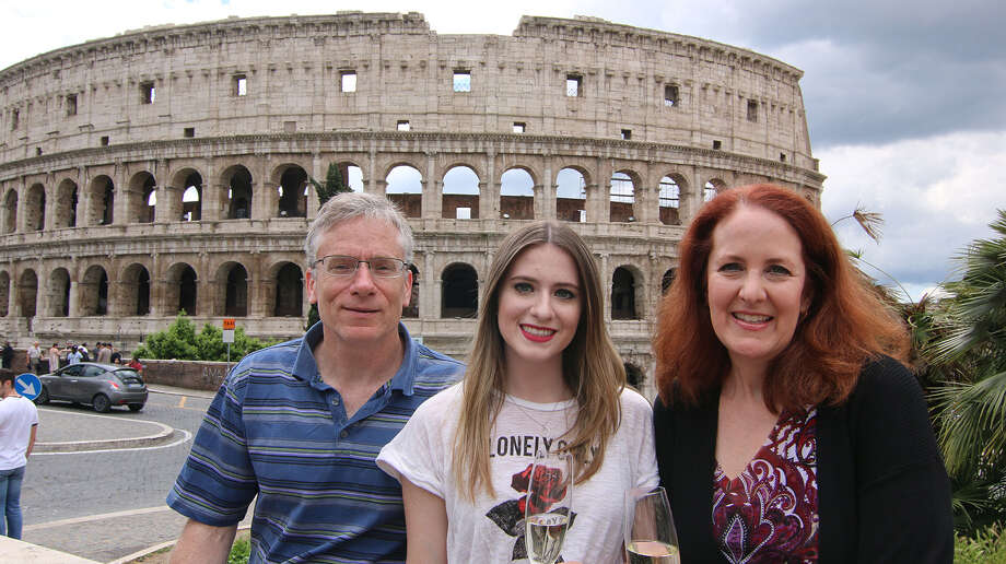 Ron and Hilary Shenfeld with their daughter Samantha outside the Colosseum in Rome. (Hilary Shenfeld/Chicago Tribune/TNS) Photo: Hilary Shenfeld / Chicago Tribune