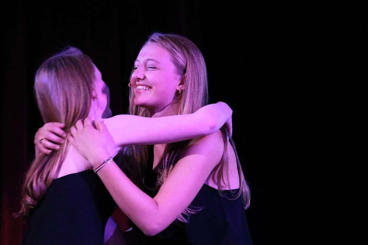 Second place PSA winner Georgia Ferguson hugs senior host Gigi Jervis during the Sacred Heart Greenwich 10th annual film festival held Thursday. The young women submitted work to four categories, creative experimental, documentary and public service announcements, which were judged by two Emmy Award-winning producers and two alumnae working in film production.