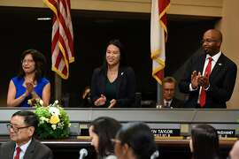 Oakland city council members Nikki Fortunato Bas, left, Sheng Thao, and Loren Taylor accnolodge the crowd after being sworn in during an inauguration ceremony for elected representatives at City Hall in Oakland, Calif., on Monday, January 7, 2019.