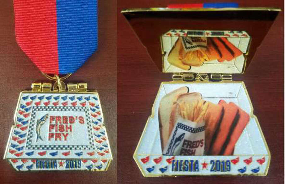 The Fred's Fish Fry medal opens to reveal a Thee-Fish Meal. It sells for $15 at the restaurant, although one was recently auctioned on eBay for $26. Photo: Courtesy, Fred's Fish Fry