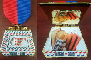 The Fred's Fish Fry medal (left and center) opens to reveal a Thee-Fish Meal. It sells for $15 at the restaurant, although one was recently auctioned on eBay for $26.