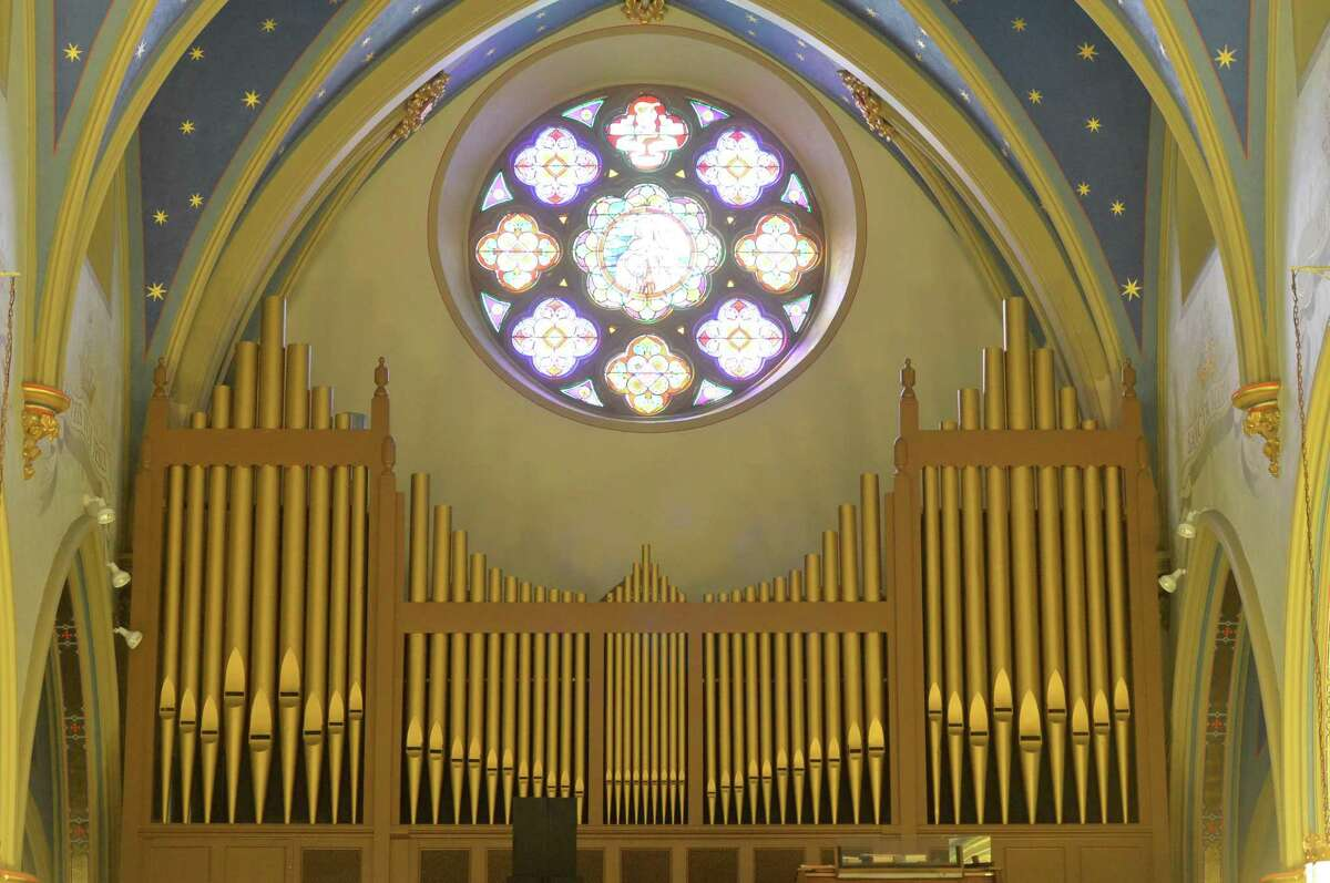 The interior and the pipe organ at St. Mary Roman Catholic Church on West Ave. in Norwalk.