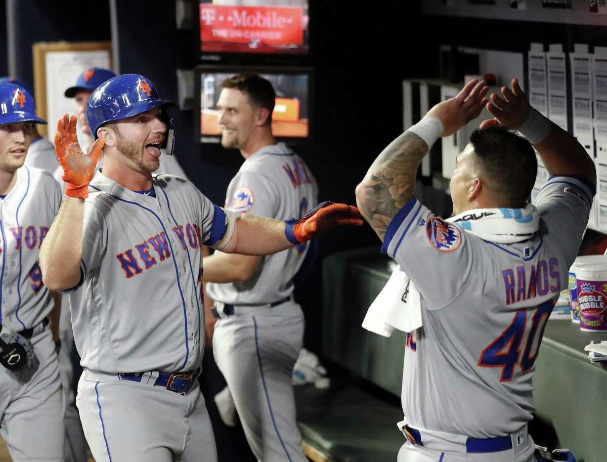 New York Mets' Pete Alonso, left, celebrates with Wilson Ramos (40) after hitting a two-run home run during the seventh inning of the team's baseball game against the Atlanta Braves April 11 in Atlanta.