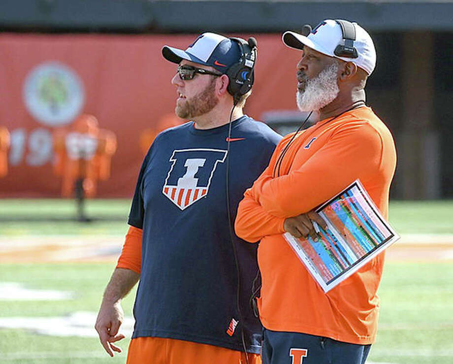 Illinois head coach Lovie Smith, right and defensive line coach Austin Clark watch a recent spring football workout at Memorial Stadium in Champaign. Photo: Craig Presman, Illinois Athletics