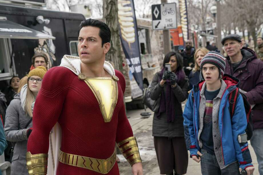 "This image released by Warner Bros. shows Zachary Levi, left, and Jack Dylan Grazer in a scene from ""Shazam!"" Photo: Steve Wilkie / Associated Press / © 2018 Warner Bros. Entertainment Inc."