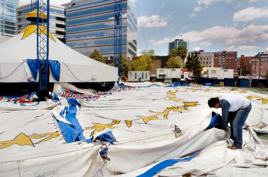 Workers at the Big Apple Circus break down the tent on Monday July 26, 2010 after a 2 week stay in Stamford, Conn. Photo: Dru Nadler / Stamford Advocate
