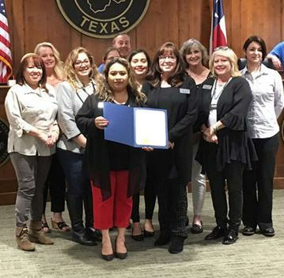 """Representatives ofKatyChristian Ministries attended the April 8 meeting ofKatyCity Council whereKatyMayor Chuck Brawner proclaimed April as """"Sexual Assault Awareness and Child Sexual Abuse Awareness Month."""" From left are, front row:Deysi Crespo, KCM executive director;Carolyn Chandler, KCM grant writer; andSusan Hastings, KCM Crisis Center director; middle row:Margie Crespo, domestic abuse client advocate;Celina Wells, sexual abuse client advocate;Lizet Benitez, KCM Crisis Center counselor, Becce Slinkard, KCM boardvice president; andKarina Andrade, domestic abuse client advocate;Back row:Patricia Wood, KCM board of directors;Mitzi Willis, sexual abuse client advocate and KatyMayor Chuck Brawner. Photo: Karen Zurawski / Karen Zurawski"""
