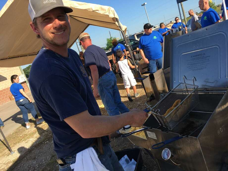 Helping to fry the catfish filets at the 39th annual Katy Police Officers Association Fish Fry and Auction is Colton Tyler. The son of Tim Tyler, Katy Police Department assistant chief, Colton is a longtime volunteer with the fish fry. Photo: Karen Zurawski / Karen Zurawski