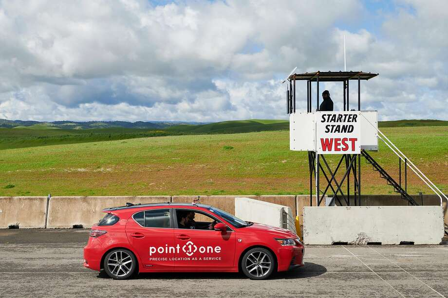 """A Lexus CT200h fielded by Point One Navigation, during Self Racing Cars, an annual open-track event for autonomous vehicles, in Willows, Calif., March 23, 2019. A racetrack veteran compares the Self Racing Cars contest to hot-rod modders of old: """"This event, with its hackers, tinkerers and engineers, is just like that."""" (Aaron Wojack/The New York Times) Photo: Aaron Wojack, NYT"""