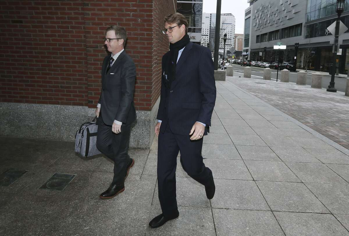 Mark Riddell arrives at federal court Friday, April 12, 2019, in Boston, where he was scheduled to plead guilty to charges in a nationwide college admissions bribery scandal. (AP Photo/Charles Krupa)