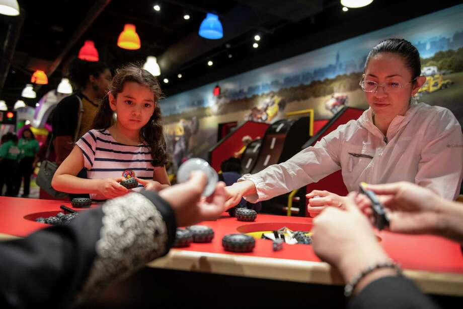 Elizabeth Marcos, 5, and Nidia Pichardo of Salt Lake City, Utah, build cars at the Build and Test portion of LEGOLAND Discovery Center on Friday, April 12, 2019. Photo: Carlos Javier Sanchez / Contributor / Carlos Javier Sanchez