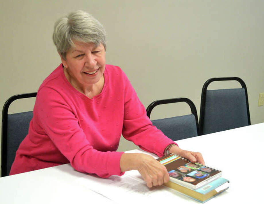 """Karen Harrick of Edwardsville starts the discussion about """"Winter Garden"""" by Kristin Hannah, which was Thursday's featured selection for the Afternoon Book Club at Main Street Community Center, 1003 N. Main St. in Edwardsville. The group, which consists of about six regular members, started in 2008 and meets once a month. The group discusses a variety of fiction and non-fiction books. Photo: Scott Marion 