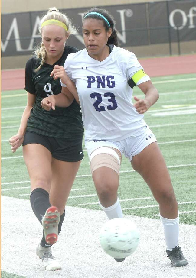 Port Neches - Groves' Ariel Muller manuevers the ball against pressure from Kingwood Park's Leah Hoyt during their regional semifinal match-up in Humble Friday. The Lady Indians fell to the Panthers 6 - 3. Photo taken Ftiday, April 12, 2019 Kim Brent/The Enterprise Photo: Kim Brent, The Enterprise / BEN