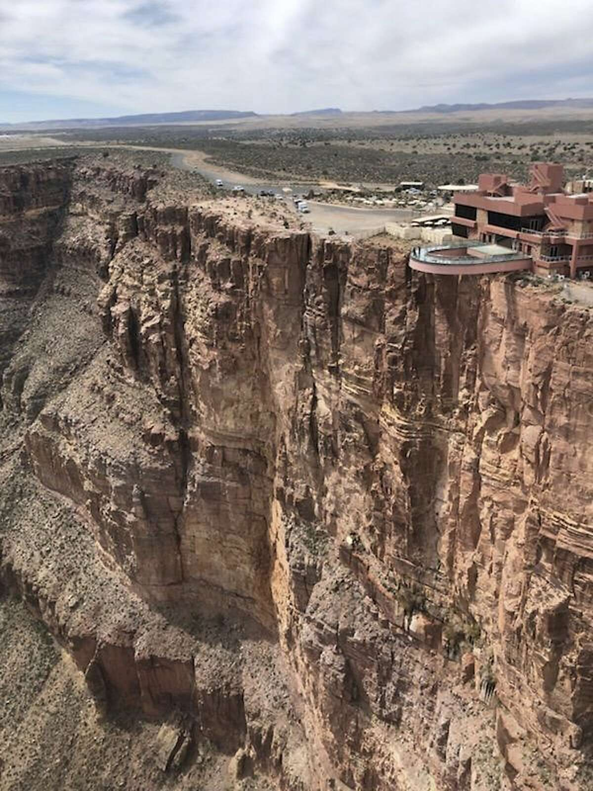 This Thursday, March 28, 2019 photo, provided by the Mohave County Sheriff's Office, shows the area where a tourist slipped and fell at the Grand Canyon on the Hualapai reservation in northwestern Arizona. The popular tourist destination on the western end of the Grand Canyon has reopened a day after the fatal fall. Eagle Point and the Grand Canyon Skywalk had closed Thursday after a Chinese man in his 50s slipped and fell while taking photographs. His body was recovered from 1,000 feet below the rim. (Mohave County Sheriff's Office via AP)