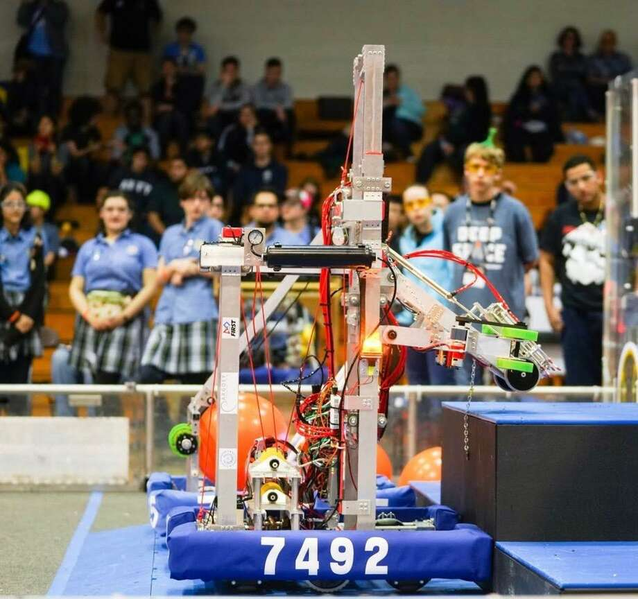 Both the Texas Torque team and CavBots rookie team have qualified for next week's FIRST Robotics World Championship competition at the George R. Brown Convention Center in downtown Houston. Here, the CavBots robot competes. Photo: Submitted Photo / Submitted Photo