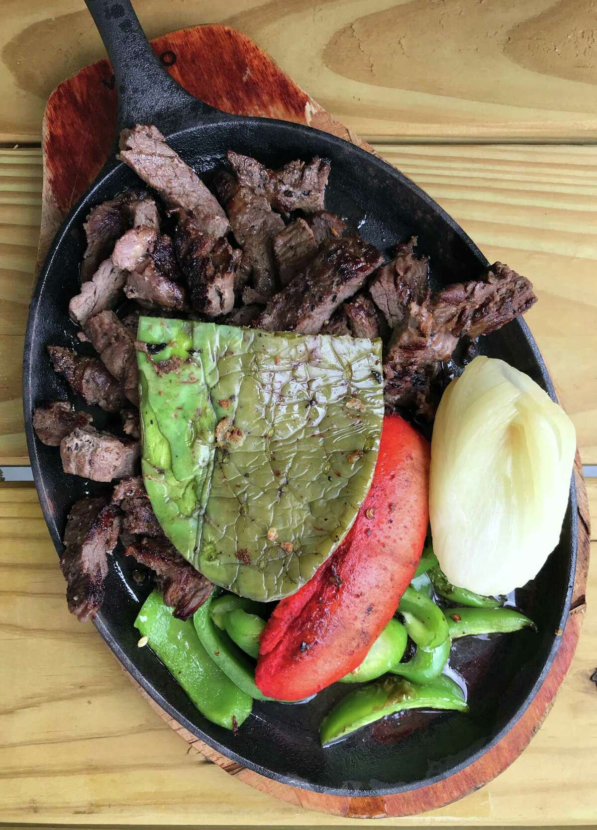 Beef fajitas with a side of grilled nopal and sausage from Pollos El Gallo.
