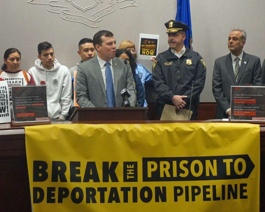 (Center) State Rep. Steve Stafstrom, D-Bridgeport, spoke in favor of strengthening Connecticut's TRUST Act at the state Capitol in Hartford, Conn. on Friday March 8, 2019 with (center right) New Haven Police Assistant Chief Luis Casanova and (far right) Sen. Saud Anwar, D-South Windsor. Photo: Emilie Munson / Hearst Connecticut Media / Connecticut Post