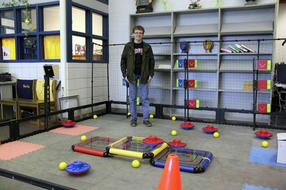 Josh Robinson is shown here on the Bad Axe robotics playing field. Robinson, who is involved in many different extra curricular activities at Bad Axe, was named this year's No. 1 student in the Huron Daily Tribune's Top 50. (Mike Gallagher/Huron Daily Tribune)