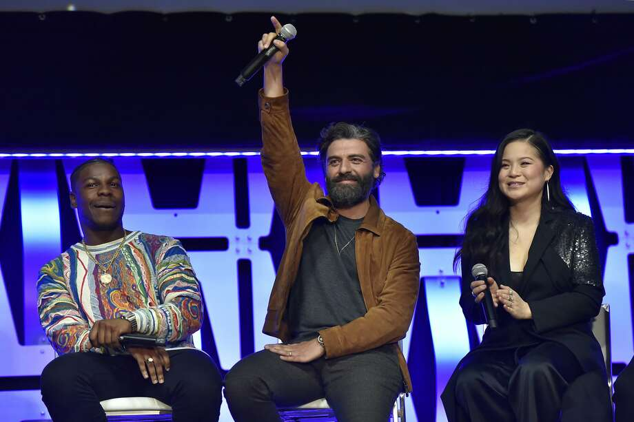 "John Boyega, from left, Oscar Isaac and Kelly Marie Tran participate in the ""Star Wars: The Rise of Skywalker"" panel on day 1 of the Star Wars Celebration at Wintrust Arena on Friday, April 12, 2019, in Chicago. (Photo by Rob Grabowski/Invision/AP) Photo: Rob Grabowski, Associated Press"