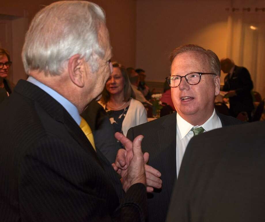 Danbury Mayor Mark Boughton, right, talks with Dick Moccia, former mayor of Norwalk, at the launch of Boughton's 2019 mayoral re-election campaign on March 14 at Anthony's Lake Club. Boughton, a nine-term GOP mayor, is already is the longest serving mayor in Danbury history, but he wants at least one more term, he said. He will face Democratic challenger Chris Setaro, an attorney and former City Council president, who has planned a fundraiser on Saturday. Among his scheduled guests is U.S. Rep. Jahana Hayes. Wednesday, March 14, 2019, in Danbury, Conn. Photo: H. John Voorhees III
