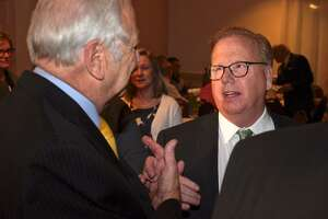 Danbury Mayor Mark Boughton, right, talks with Dick Moccia, former mayor of Norwalk, at the launch of Boughton's 2019 mayoral re-election campaign on March 14 at Anthony's Lake Club. Boughton, a nine-term GOP mayor, is already is the longest serving mayor in Danbury history, but he wants at least one more term, he said. He will face Democratic challenger Chris Setaro, an attorney and former City Council president, who has planned a fundraiser on Saturday. Among his scheduled guests is U.S. Rep. Jahana Hayes. Wednesday, March 14, 2019, in Danbury, Conn.