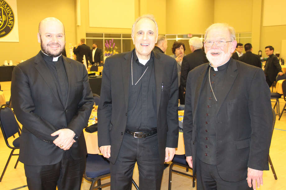 Father Jeff Bame, Cardinal Daniel DiNardo (center) and Auxiliary Bishop George Sheltz at a dinner at St. Mary's Seminary in Houston April 10, 2019. >> See photos of Daniel DiNardo's 2007 journey to the Vatican to become a cardinal.... Photo: Jonah Dycus,  Courtesy Of The Archdiocese Of Galveston-Houston