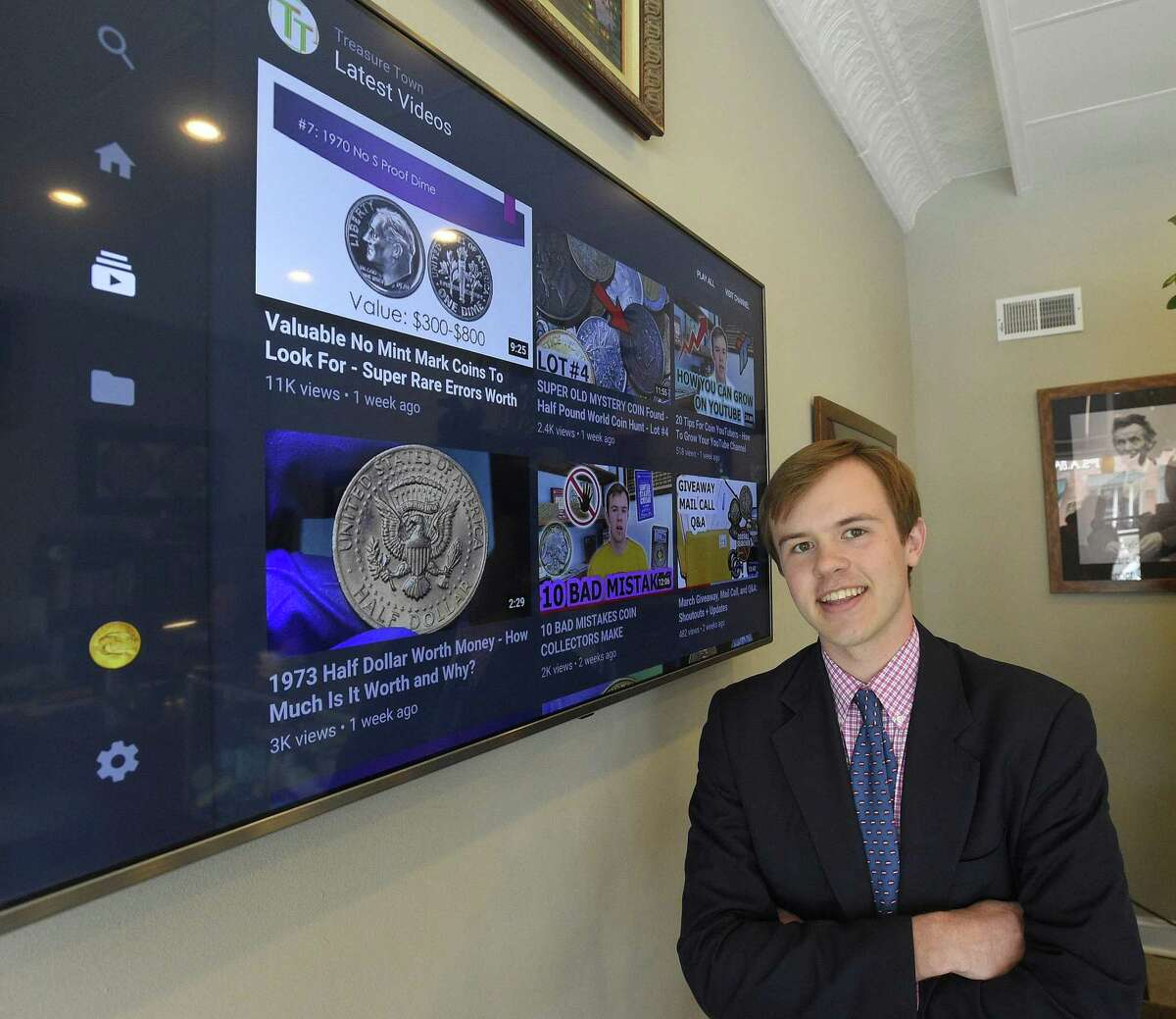 Christian Hartcher, an avid coin collector who has a YouTube following of 18,000 subscribers, is photograph Thursday, April 11, 2019 at his place of employment, Happy Coins in Greenwich, Connecticut. Hartcher is holding a rare 1936 D Cincinnati Commemorative Silver Half Dollar coin, that was recently sold to a private collector.