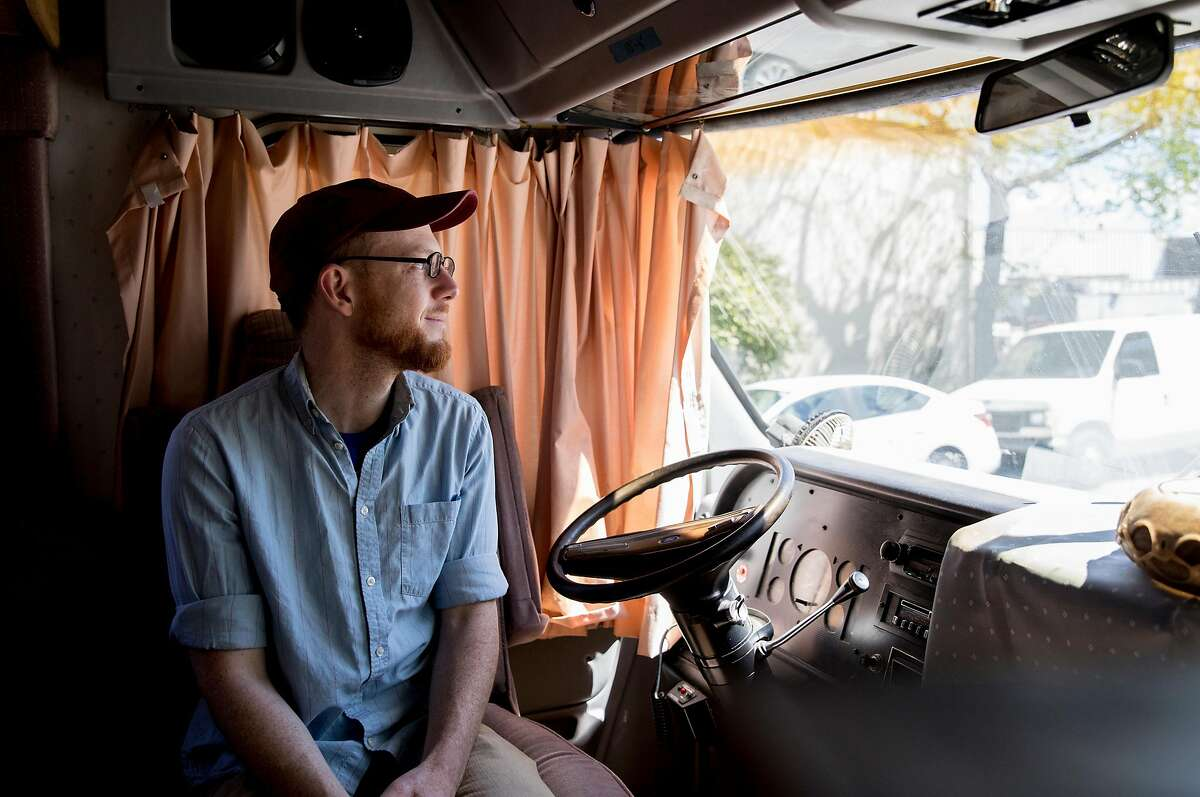 Paul Kastner looks out the front window from the driver's seat of his RV parked along 8th Street in Berkeley, Calif. Tuesday, April 9, 2019.
