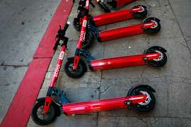 Scoot scooters on the sidewalk on Mission and 1st Streets in San Francisco, California, on Monday, Oct. 15, 2018.