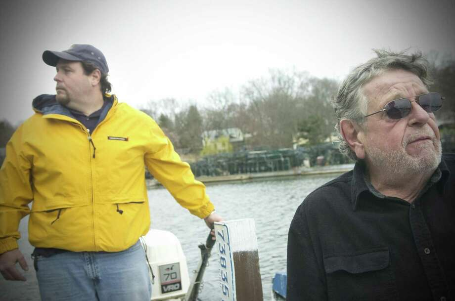 Gus Bertolf Jr. and his father, Gus Bertolf Sr., check on their lobster traps on a barge in the Mianus River. Photo: KATHLEEN O'ROURKE / ST