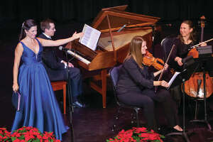 "Soprano Sofia Troncoso with members of the Opera Edwardsville Orchestra at nonprofit Opera Edwardsville's sold out inaugural concert, ""Opera Edwardsville presents Christmas at the Wildey,"" last Dec. 22."