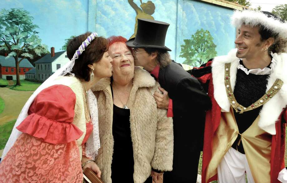 Gina Clarizio as Queen Isabella, left, Billy Michael, center, and Rob Volpintesta as Christopher Columbus, congratulate Geraldine Mills on her 80th birthday during the Columbus Day ceremonies at P.T. Barnum Square in Bethel, Oct. 11, 2010. Photo: Michael Duffy / Hearst Connecticut Media / The News-Times