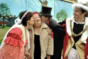 Gina Clarizio as Queen Isabella, left, Billy Michael, center, and Rob Volpintesta as Christopher Columbus, congratulate Geraldine Mills on her 80th birthday during the Columbus Day ceremonies at P.T. Barnum Square in Bethel, Oct. 11, 2010.
