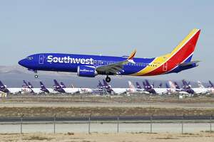 FILE - In this March 23, 2019 file photo a Southwest Airlines Boeing 737 Max aircraft lands at the Southern California Logistics Airport in the high desert town of Victorville, Calif.  Southwest is removing flights with the troubled Boeing 737 Max aircraft from its schedule through Aug. 5, a period that includes the peak of the airline's busy summer travel season. The company did not specify how many flights would be cancelled because of the new schedule. (AP Photo/Matt Hartman, File)