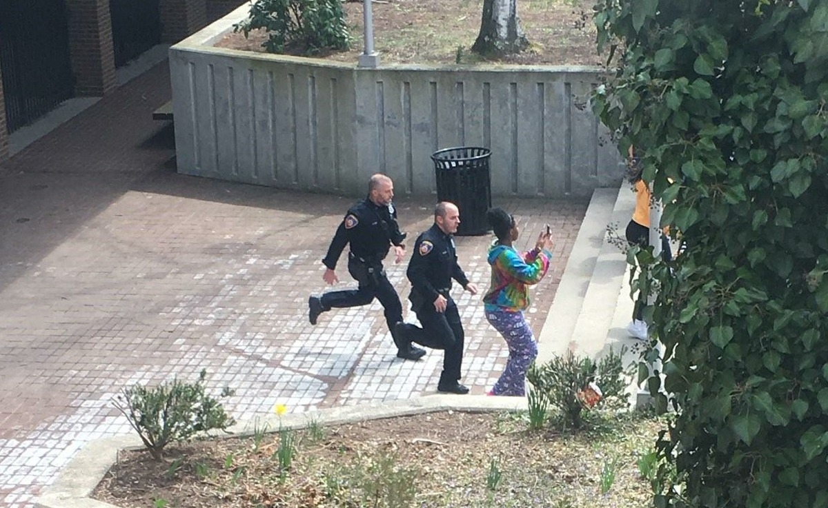 Two officers and a teacher responding to a near riot in the Westhill High School courtyard early Friday afternoon. One school resource officer received a head injury in the melee.