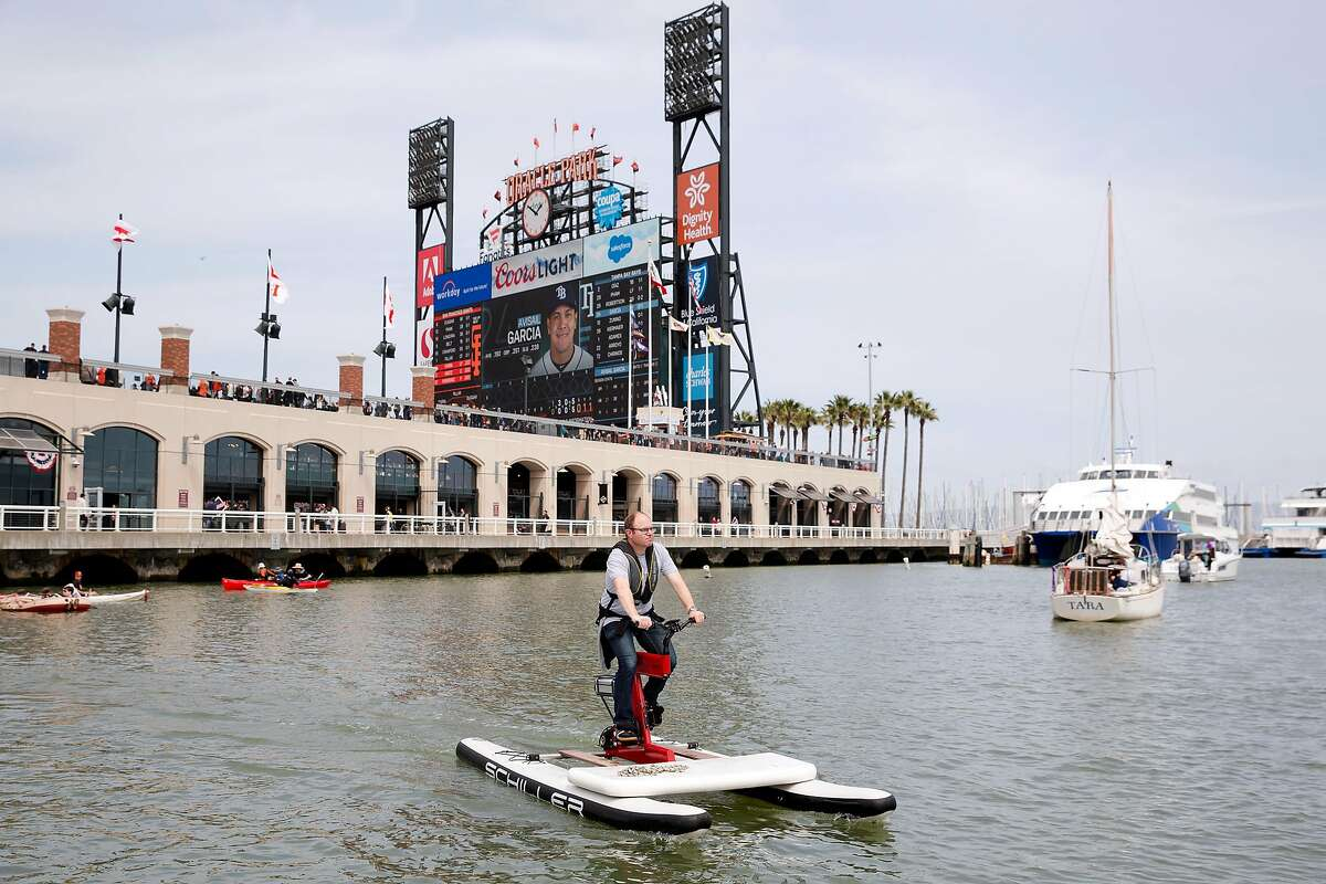Matthew Shambroom pedals an electric-assisted water bikes during a demonstration of the bikes at McCovey Cove in San Francisco, Calif. on Sunday, April 7, 2019.